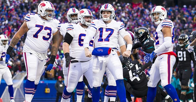 Josh Allen and the Bills defense have brought them a winning record thus far.