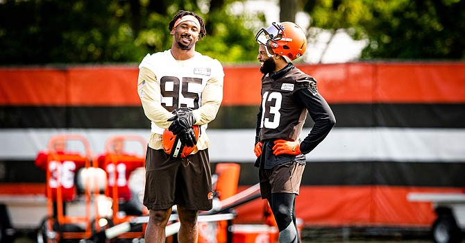 Myles Garrett and Odell Beckham Jr. share a laugh at Browns practice on Tuesday. (Cleveland Browns)