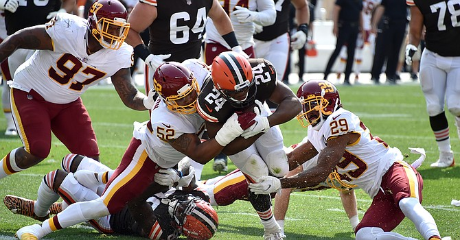 Nick Chubb muscles in for his first of two touchdowns during Browns' 34-20 win. (Jason Miller/Getty Images)