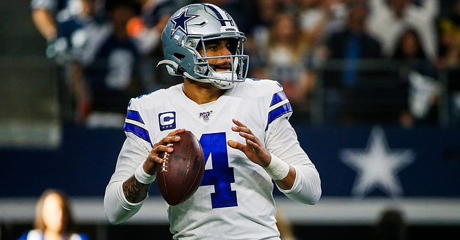 Despite a coaching change, Cowboys quarterback Dak Prescott once again is leading the NFL's No. 1-ranked offense in total yards.