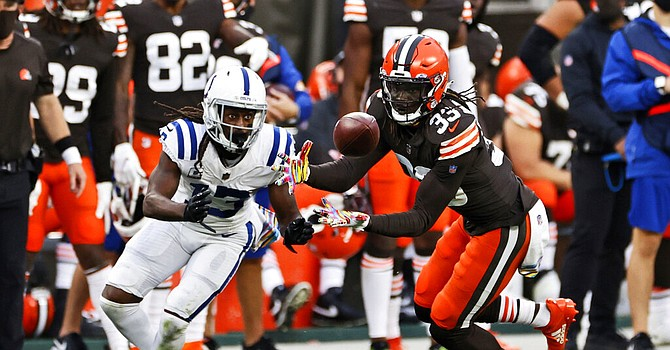 Ronnie Harrison electrifies the home crowd with a 47-yard pick six during Browns' 32-23 victory. (Ron Schwane/Associated Press)