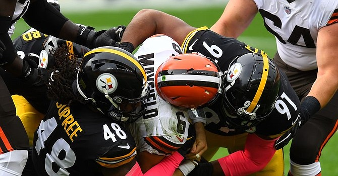 The Pittsburgh defense roughed up Baker Mayfield in the first half as Mayfield threw two interceptions including one for a touchdown. (Joe Sargent/Getty Images)