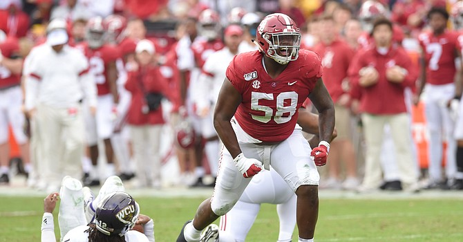 Alabama defensive tackle Christian Barmore would fortify the interior of the Browns' defensive line. (USA Today)