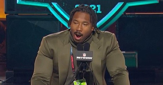 Myles Garrett's biceps almost burst out of his suit jacket at the NFL Draft. (ESPN)